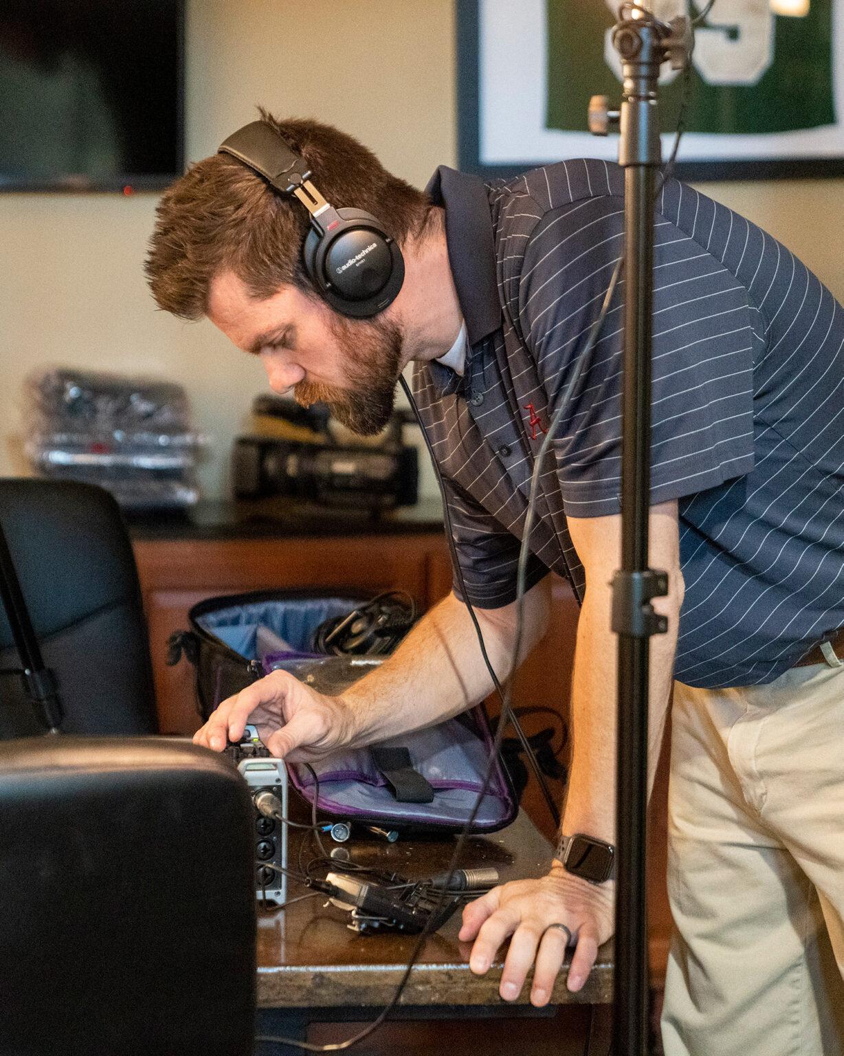 Phillip with camera and audio equipment